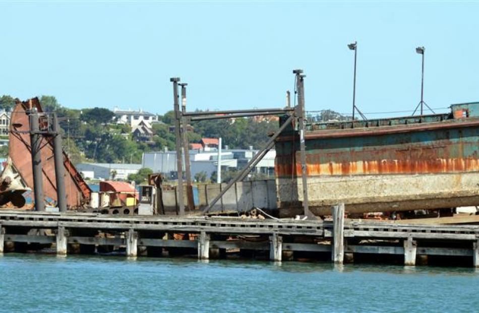The last of the former steam powered dredge Te Whaka on the Birch St slip yesterday. Photos by...