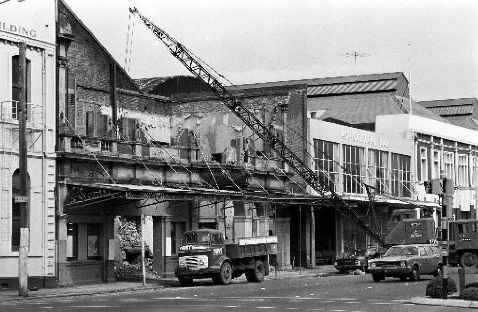 The last of the old facade being removed in 1975.