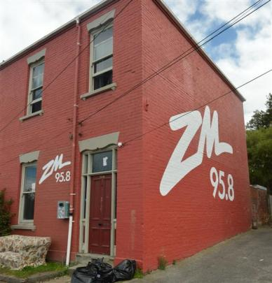 The logos on this Castle St, Dunedin, flat are to be removed. Photo by Peter McIntosh.