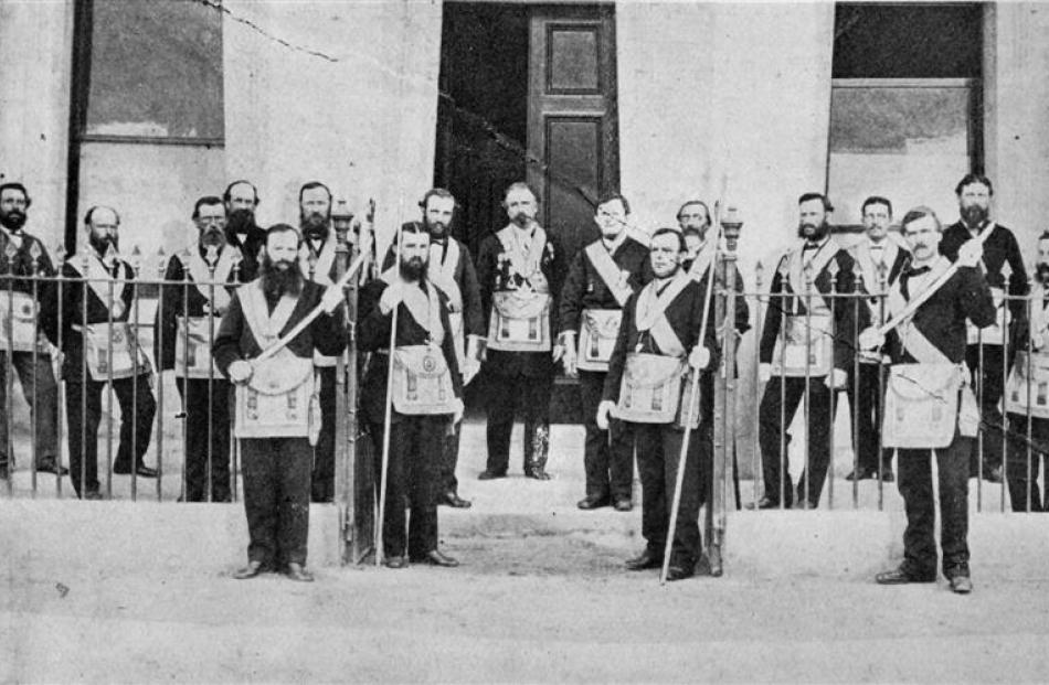The Masonic Lodge at Clyde in the early days. Among those in the back row are (from left): W....