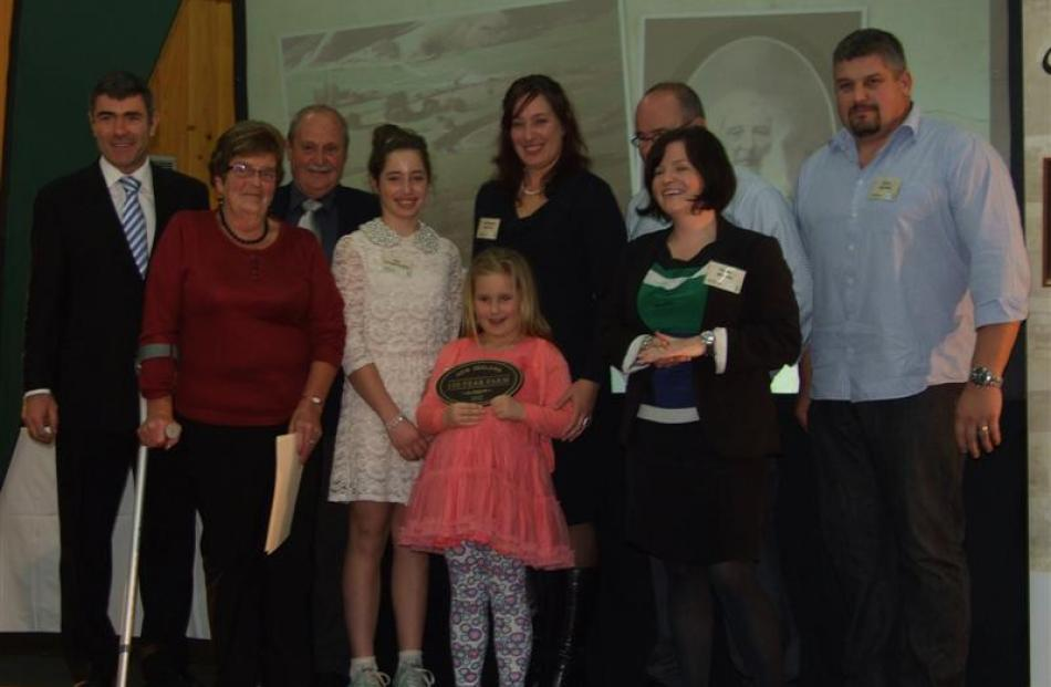 The Moore family, of Pukepito and Berwick, receive their sesquicentennial (150 year) award at the...