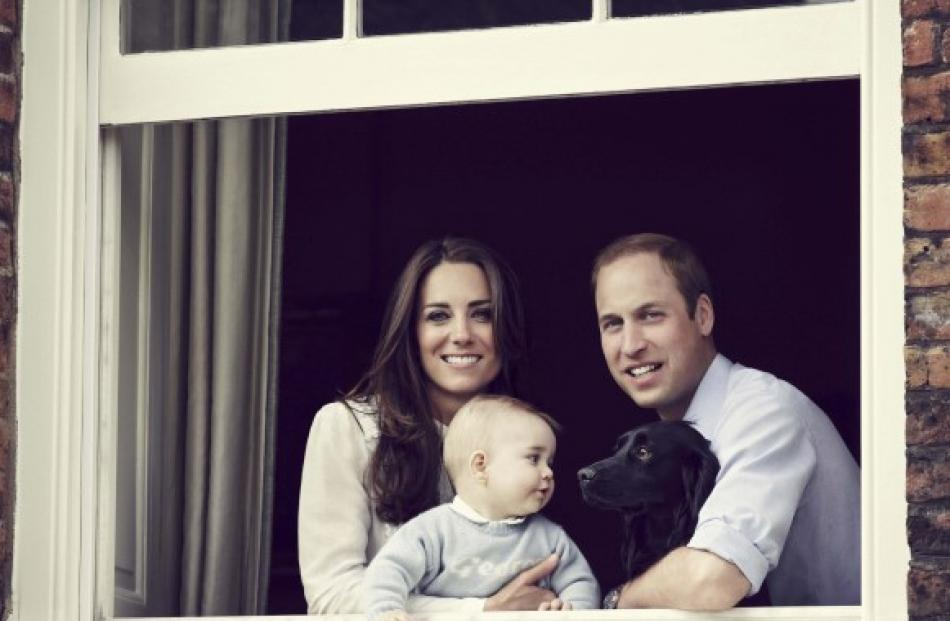 The new photo of Prince William, Catherine, Duchess of Cambridge and their son Prince George....