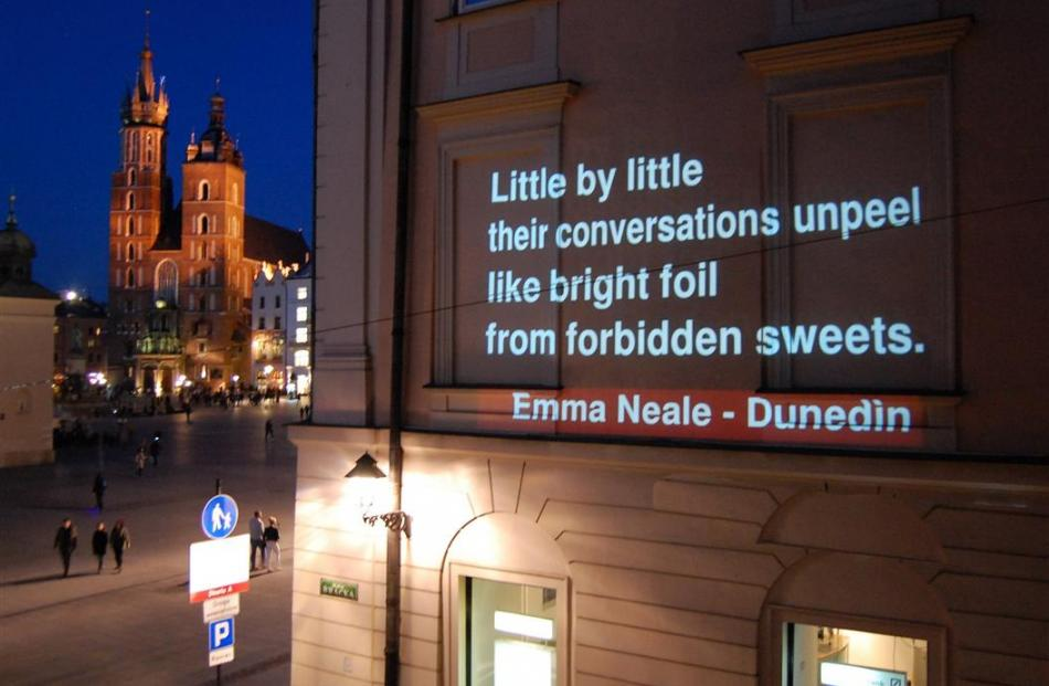 The poem Subtext  by Dunedin writer Emma Neale is projected on a central Krakow building. Photo...