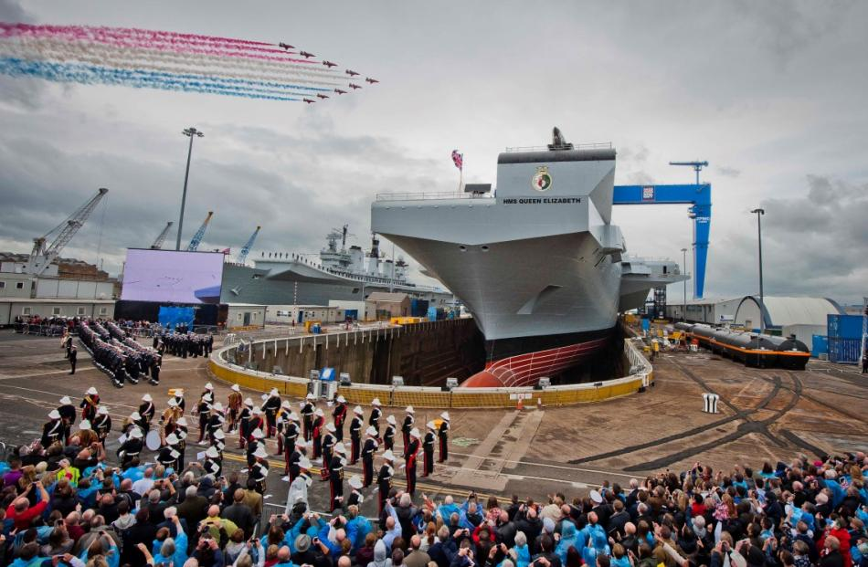 The RAF aerobatic team Red Arrows mark the naming of the new aircraft carrier HMS Queen Elizabeth...