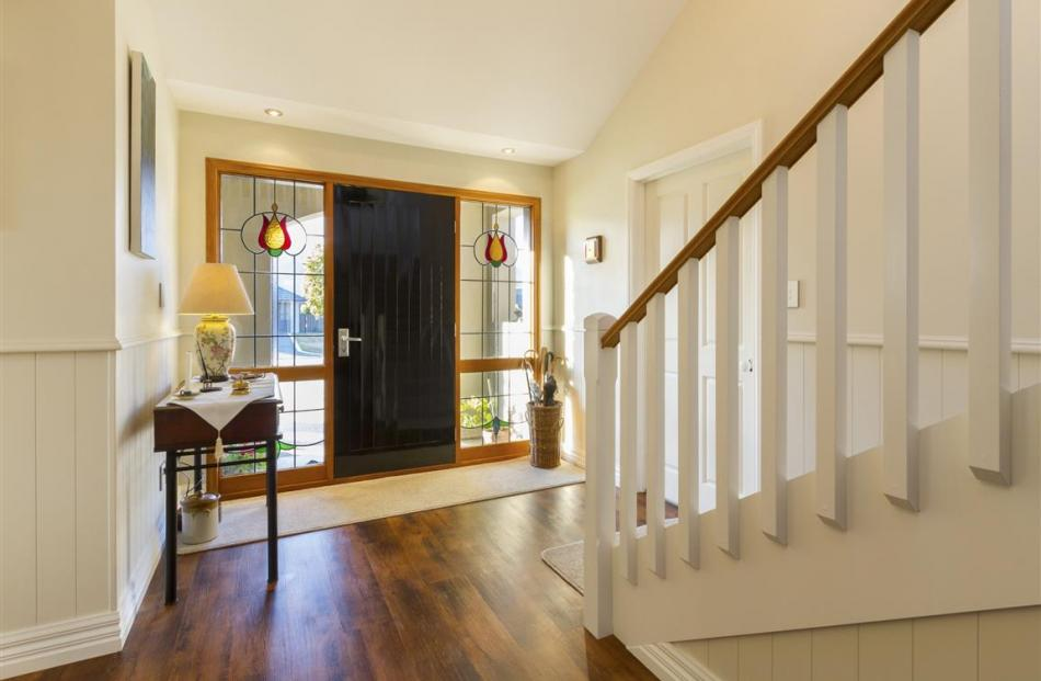 The recycled front door of Fred Black and Trish O'Neill's Cromwell house leads into a spacious...
