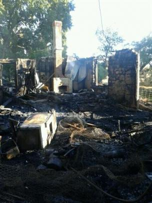 The remains  of the historic mudbrick house after the fire. Photo supplied.
