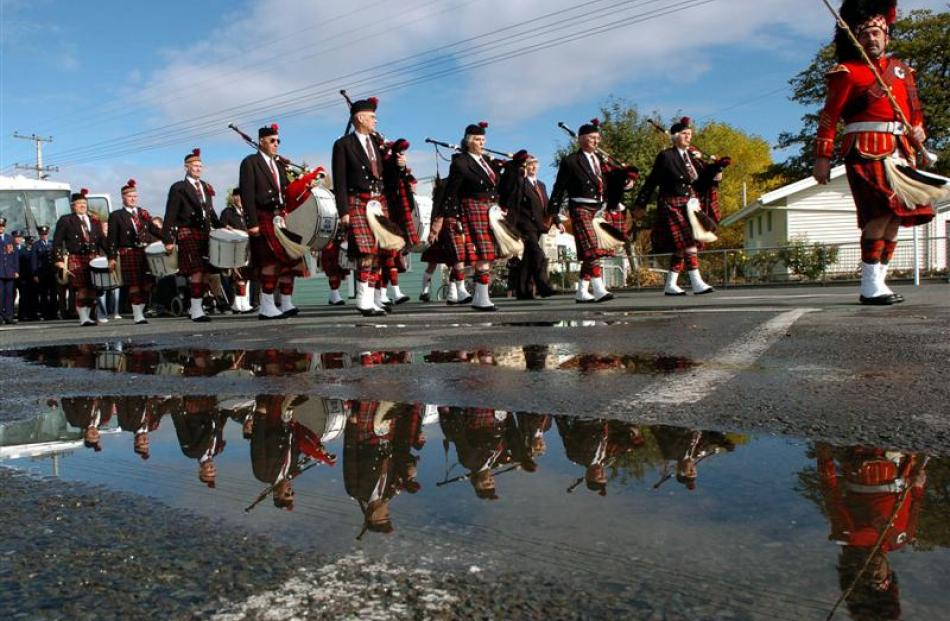 The RSA Taieri Pipe Band perform in a Middlemarch Anzac Day service. Photo by Stephen Jaquiery.