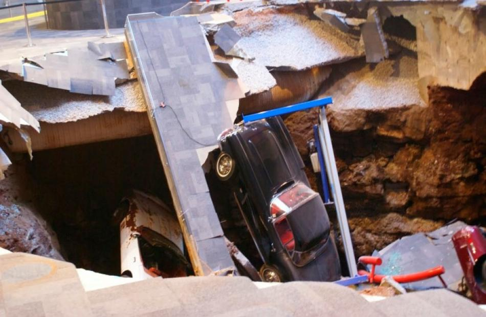 The sinkhole swallowed eight cars, including the one-millionth Corvette built in 1992. Photos:...