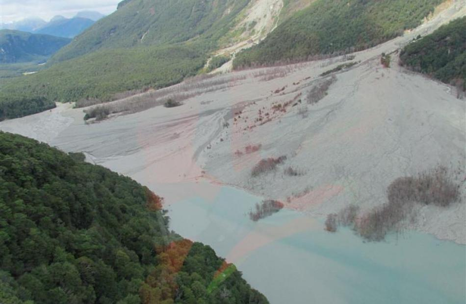 The site of the huge landslip down across the valley. Photos by DOC.
