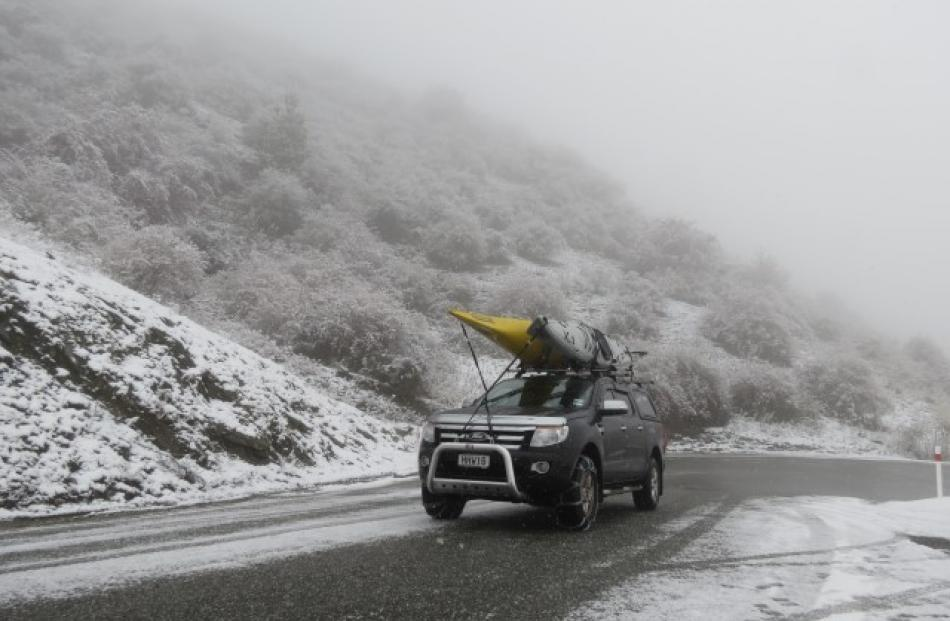 The use of chains allowed this kayak-carrying vehicle to tackle the Crown Range road between...