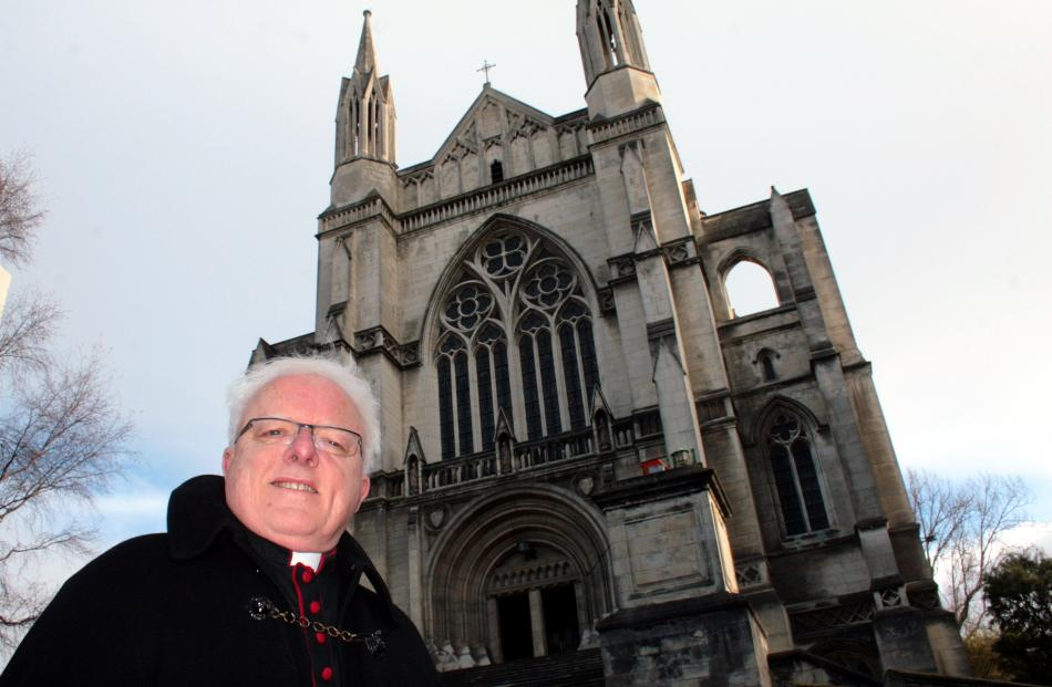 The Very Rev Dr Trevor James takes a stroll around St Paul's Cathedral in the Octagon. Photo by...