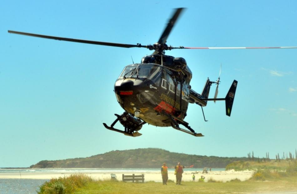 The Otago Regional Rescue Helicopter lands with two of the fishermen rescued near Taieri Mouth....