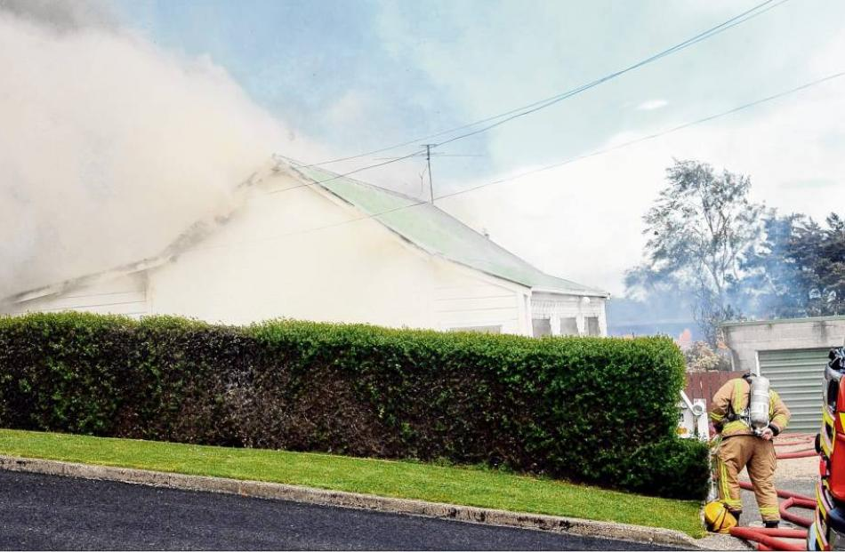 This wooden cottage on Loudon St was severely damaged by a fire started at a neighbouring...