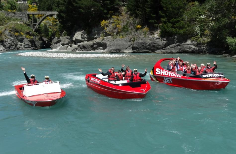 Three generations of Shotover Jet boats perform a drive-past for guests at the tourism operator's...