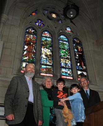Thrilled to see their window on display are (from left) Maia stained glass artist Peter Mackenzie...