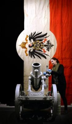 Toitu Otago Settlers Museum collections assistant Beth Rees adjusts a World War 1  German medium...