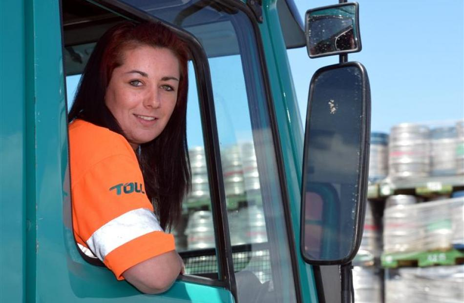 Toll truck driver Amy Perkins in a Volvo truck at the Dunedin depot. Photo by Stephen Jaquiery.
