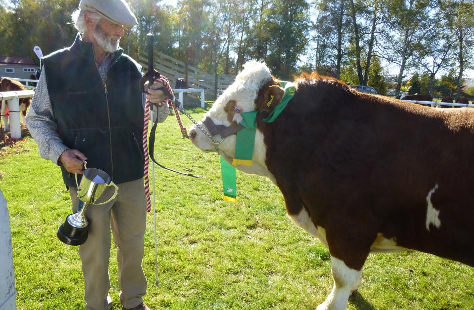 Tony Partridge, of Leeston, accepts the Lowry Austin Memorial Trophy for his Simmental bull,...