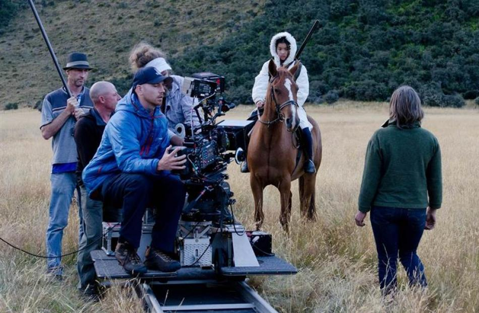 "Top of the Lake director of photography Adam Arkapaw and film crew work on set with ""Tui"", played..."