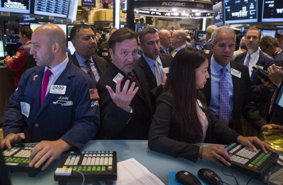 Traders at work on the floor of the New York Stock Exchange. Photo by Reuters.
