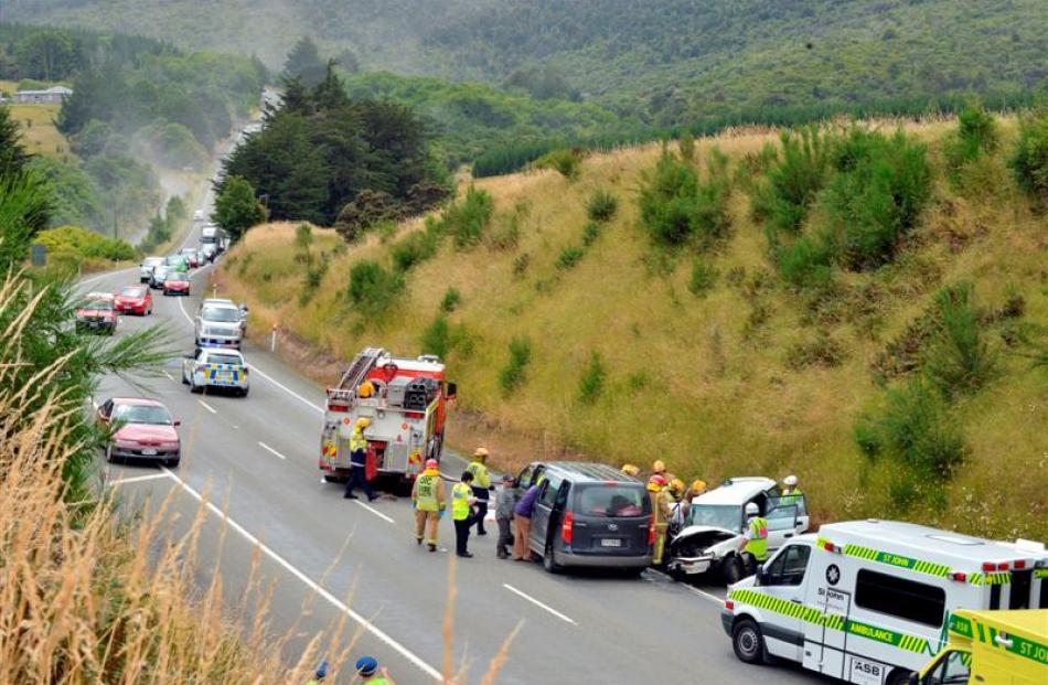 Traffic on Dunedin's Northern Motorway passes crashed vehicles in the southbound lane, while...