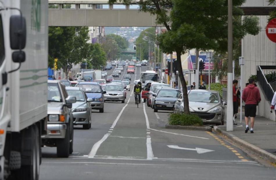 Traffic, unprotected cycle lanes and car doors can create serious cycle hazards. Photo by Stephen...