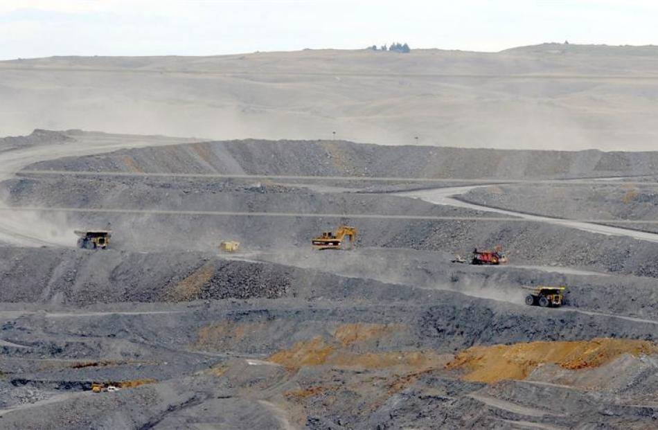 Trucks move ore at Oceana Gold's Macraes open pit in East Otago. Photo by Craig Baxter.