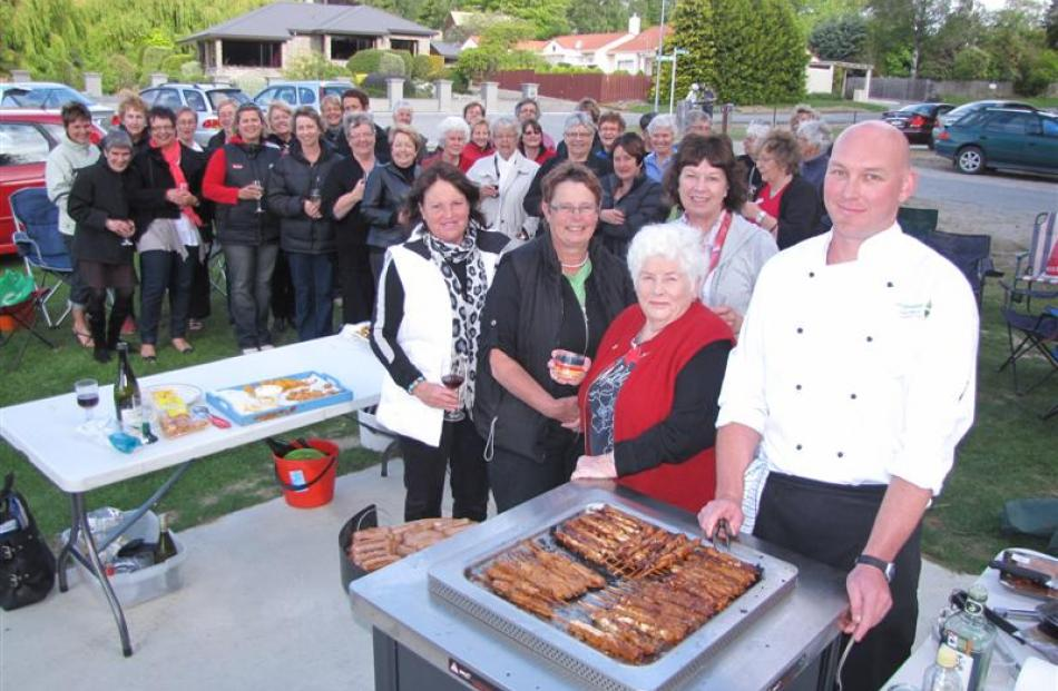 Trying out a new barbecue recently installed by the Upper Clutha Lions Club at Wanaka's Bremner...