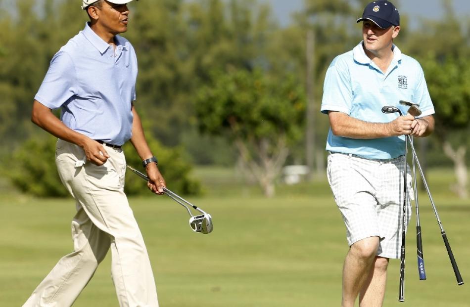 U.S. President Barack Obama plays golf with New Zealand Prime Minister John Key at Marine Corps...