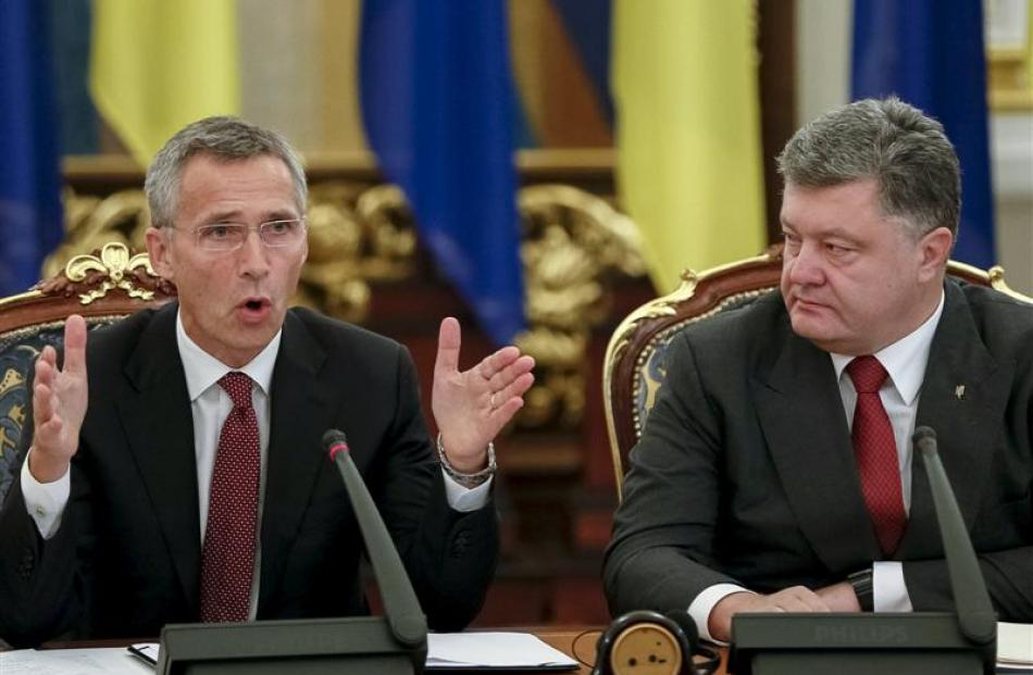 Ukraine President Petro Poroshenko (right) and Nato Secretary-general Jens Stoltenberg attend the...
