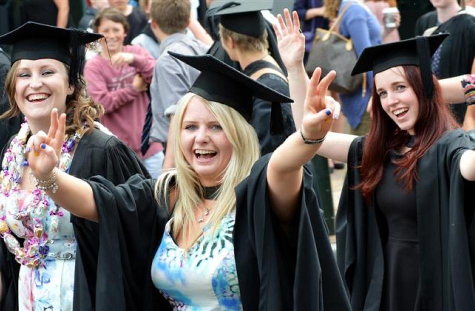 University of Otago graduands (from left) Kyra Dawson (23), Livi Geddes (22) and Chauntelle Marr ...