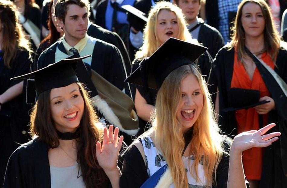 University of Otago graduands Mercy Moxhan (21, left) and Alex Noble (21) during their graduation...