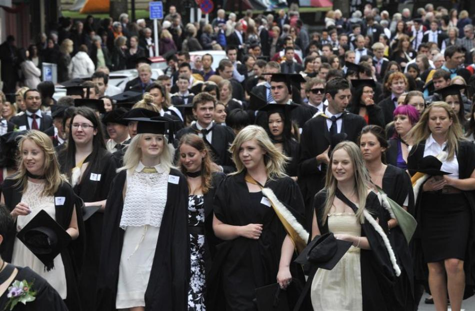 University of Otago graduands take part in an academic parade along Stuart St, Dunedin, before...