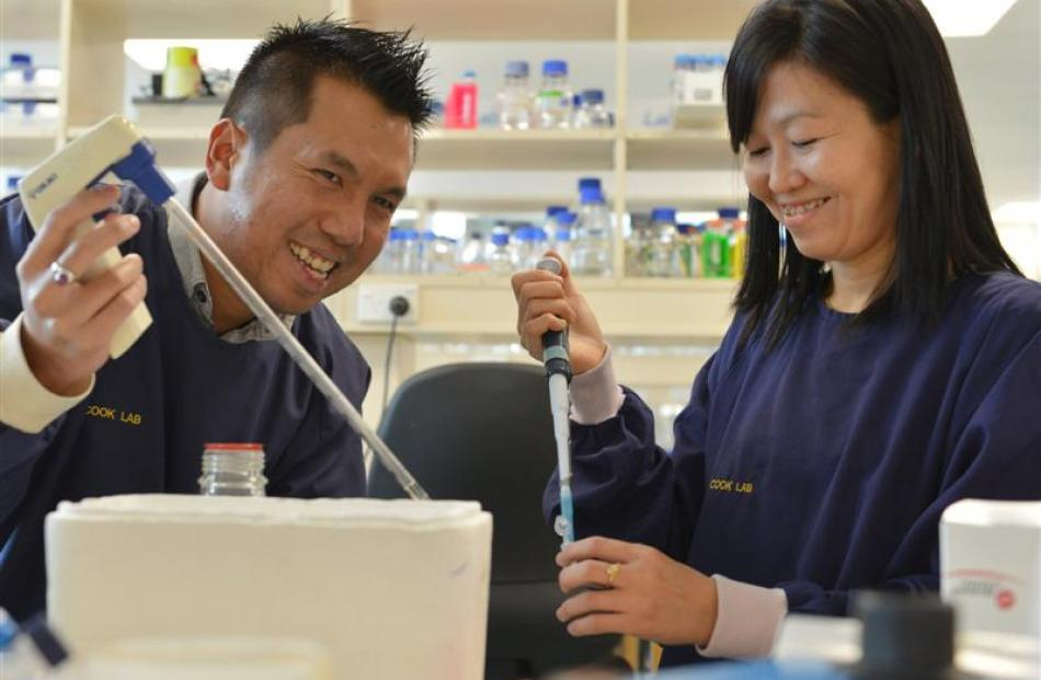 University of Otago postdoctoral research fellow Dr Htin Lin Aung (left) and  visiting medical...