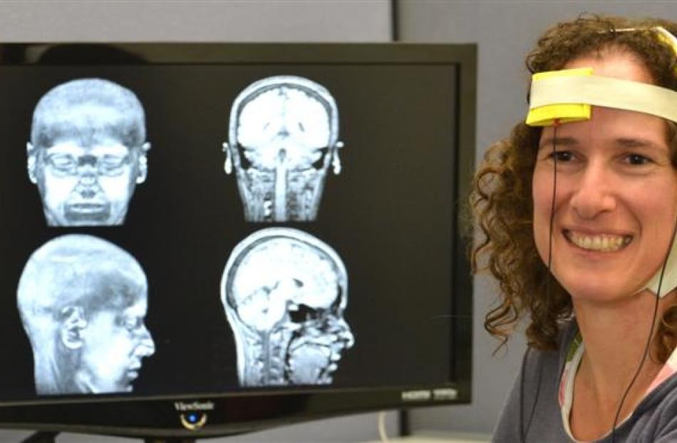 University of Otago psychology department researcher Dr Liana Machado wears equipment that can be...