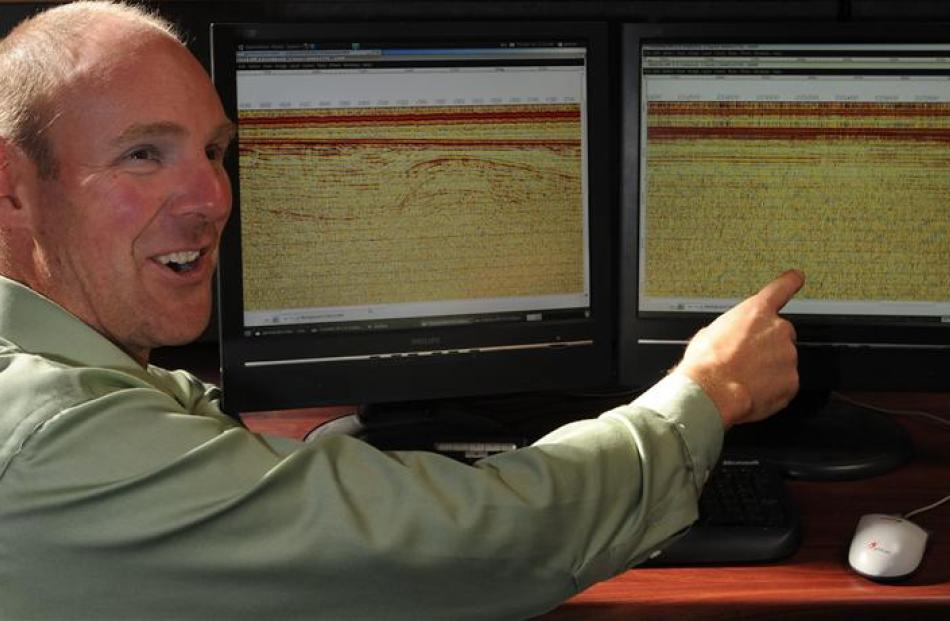 University of Otago seismologist Dr Andrew Gorman points to details in sea-floor imagery...