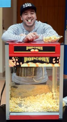 University of Otago student Geordi Dearns hands out popcorn during the Be Your Own Boss Expo in...