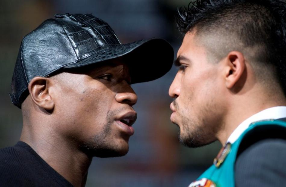 US boxers Floyd Mayweather Jr. (L) and WBC welterweight champion Victor Ortiz face off during a...