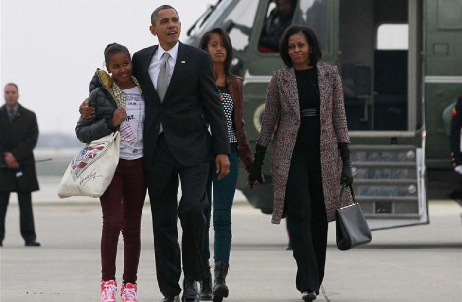 US President Barack Obama, First Lady Michelle Obama and their daughters,  Sasha (left) and Malia...
