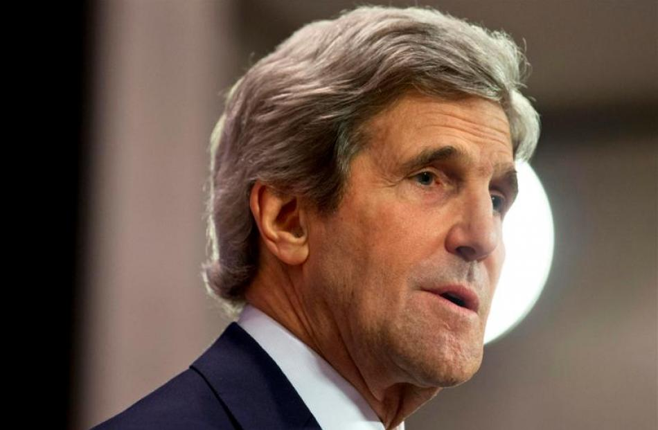 US Secretary of State John Kerry speaks during a news conference at the NATO headquarters....