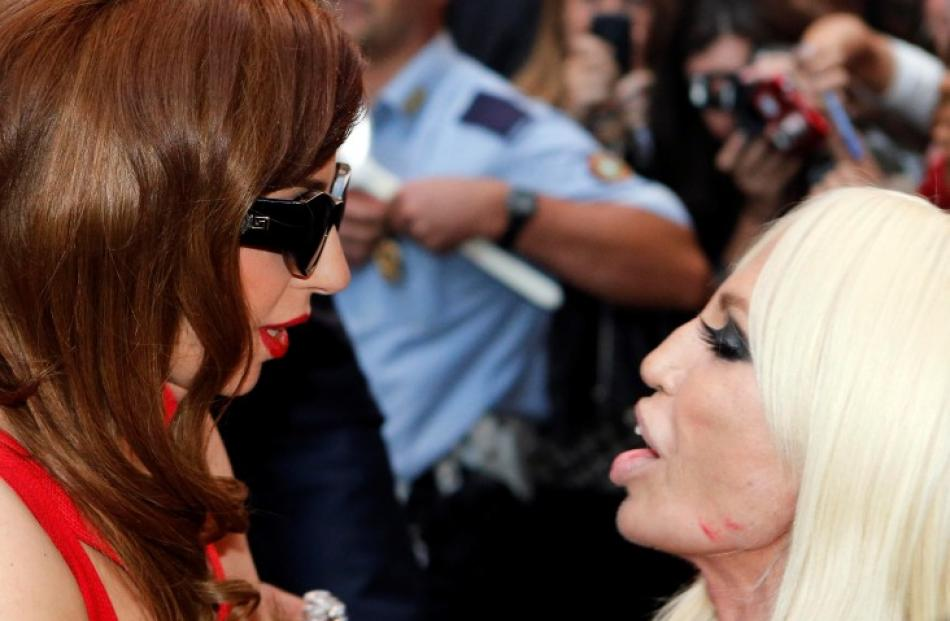 US singer Lady Gaga (L) meets Italian designer Donatella Versace in front of the Gianni Versace...