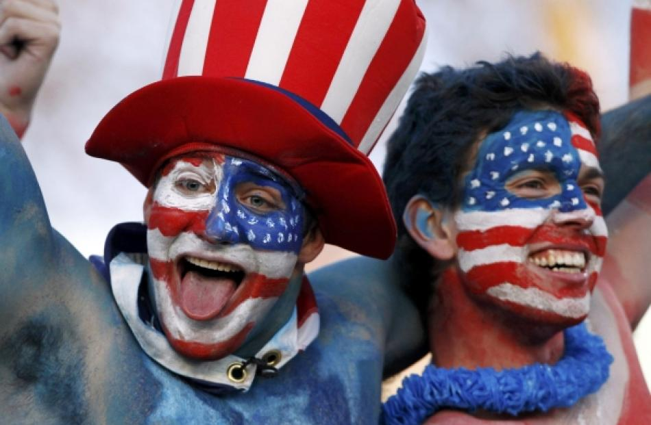 US supporters cheer before their Rugby World Cup Pool C match against Italy at Trafalgar Park in...