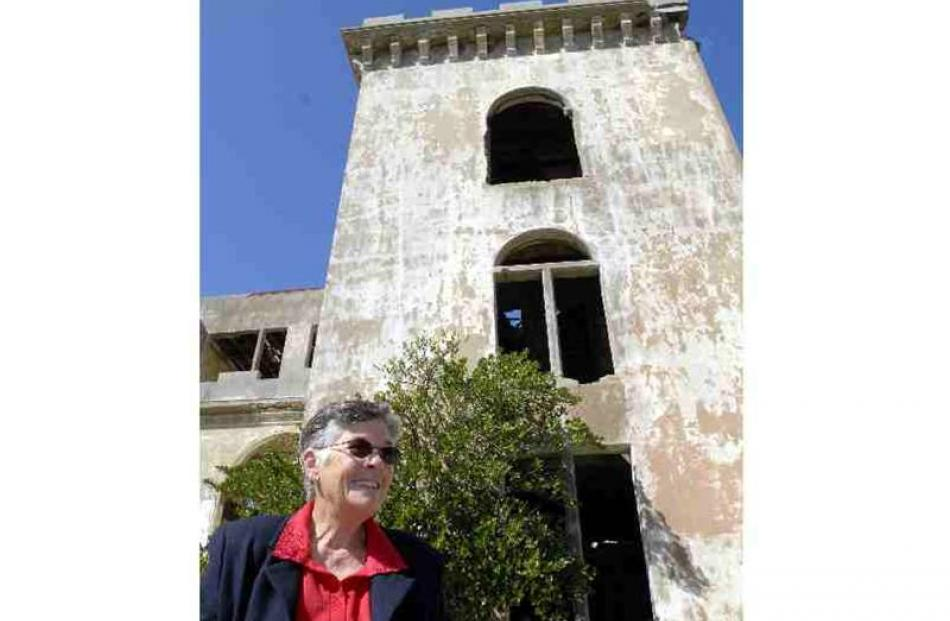 Val Wilson stands by the ruins of her former home, Cargill's Castle. To her right is what was her...