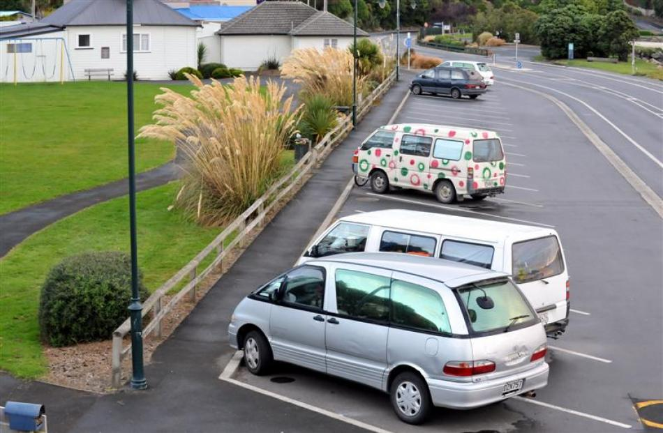 Vans parked at Ralph Ham Park in Macandrew Bay. Photo by Gregor Richardson.