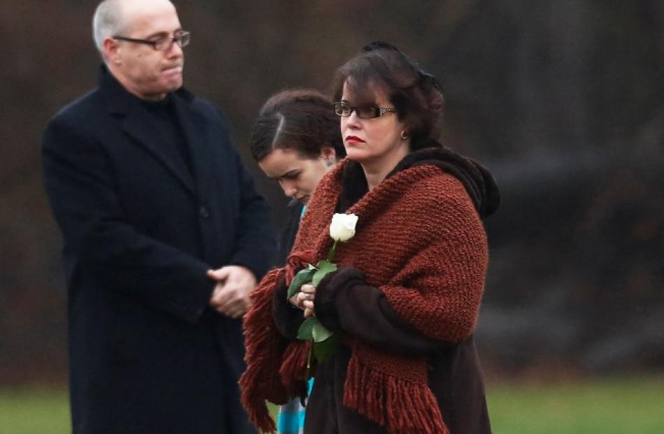 Veronique Pozner, mother of Sandy Hook Elementary school shootings victim Noah Pozner, holds a...