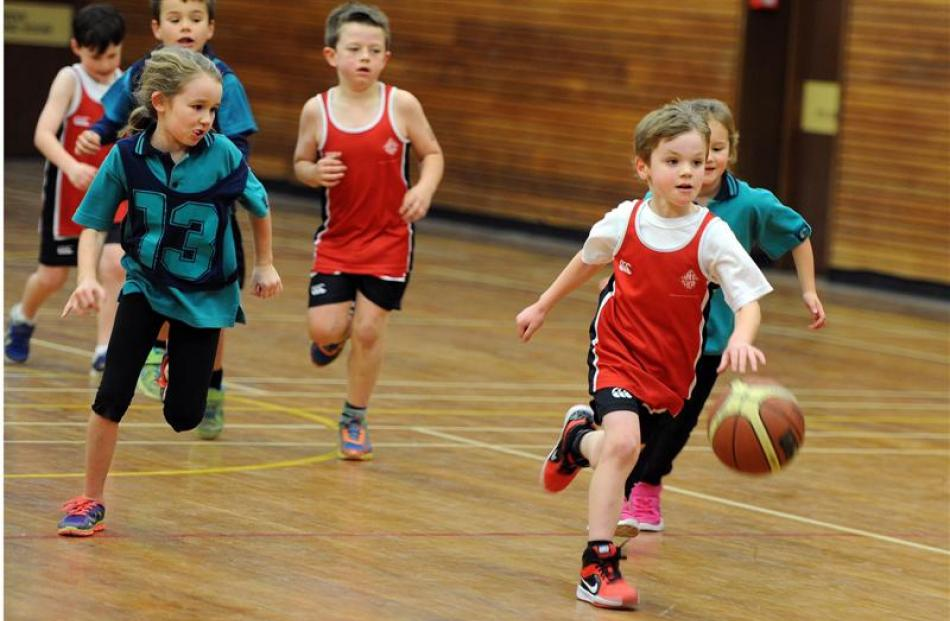 Victor Christoff (7), of  Fairfield School, leads the charge in the Taieri miniball competition...