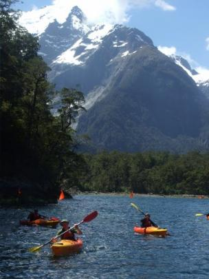 Visitors paddle back to the Discovery Centre, with Harrisons Valley and the Pembroke Glacier  in...