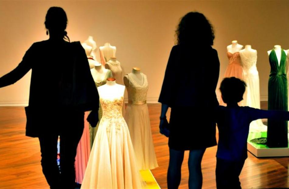 Visitors take in  Tanya Carlson's ''Not All White'' collection at the Dunedin Public Art Gallery...