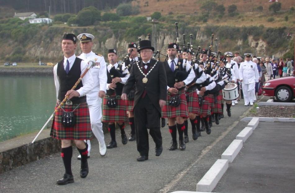 Waitaki District Schools' drum major Stephen Strachan leads Royal New Zealand Navy representative...