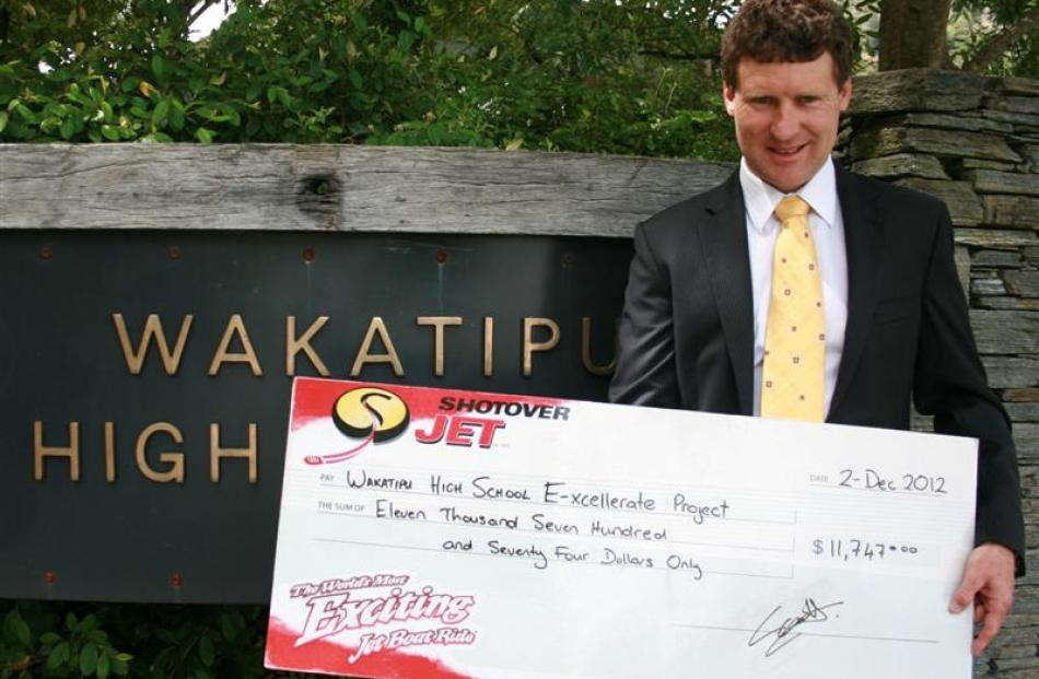 Wakatipu High School principal Steve Hall with a cheque for $11,747, raised through the Shotover...